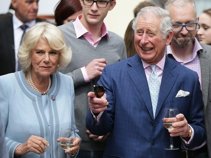 Just a tipple! Charles and Camilla enjoy a splash of vino.