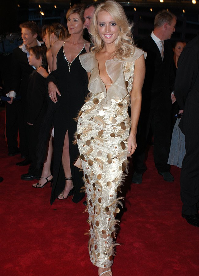 Radio host Jackie O in gold ruffles and feathers at the 2003 Logie Awards.
