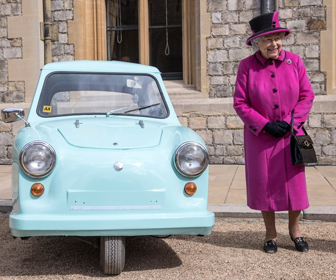 """Birthday girl Queen Elizabeth was a vision in vibrant Magenta. The only thing that could brighten her splendid coat was her adorable sidekick, a 1960s Del Boy style three-wheeler vehicle. Maybe it will have run on the next season of the [*The Crown!*](http://www.nowtolove.com.au/celebrity/tv/the-crown-season-two-release-date-36531