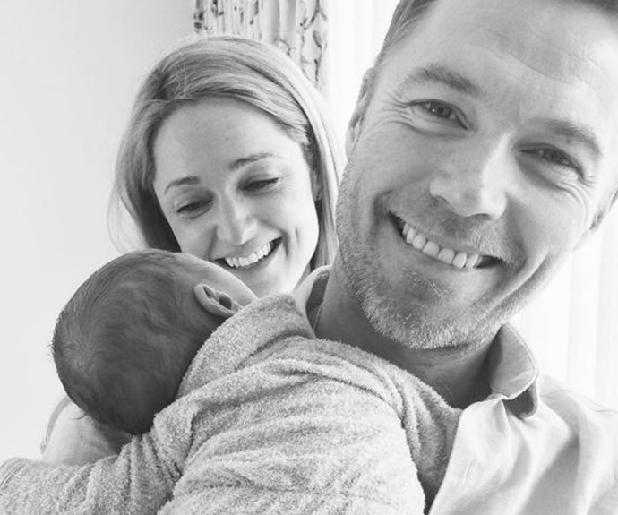 """New mum Storm Keating is clearly smitten with her little family of three, posting this happy snap of herself, husband Ronan Keating and baby Cooper lovingly to Instagram, writing: """"Happiness is... 💙 #MonkeyHug."""" Too cute for words."""
