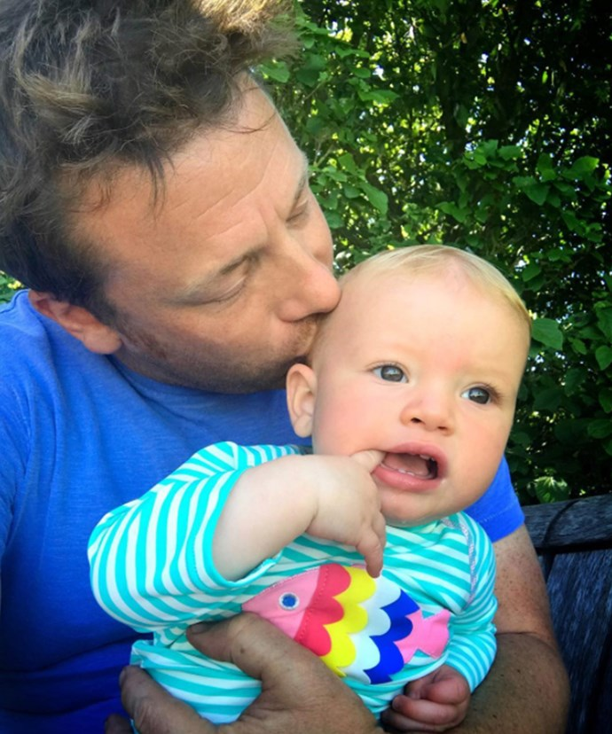 """Jamie Oliver has taken to Instagram to show off his little """"munchkin"""". How much does the 10-month-old already look like his famous daddy?!"""