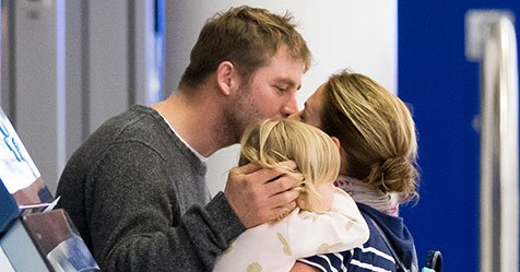 PICTURE EXCLUSIVE: Kate Ritchie and Stuart Webb's romantic airport reunion with Mae