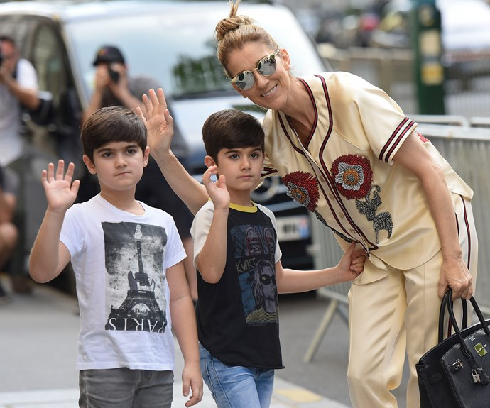 Celine Dion has stepped out in Paris with twins Nelson and Eddy, six, in a rare appearance. The boys, who lost their father René Angélil to throat cancer in January last year, appeared to be in good spirits as they spent some quality time with their mum.