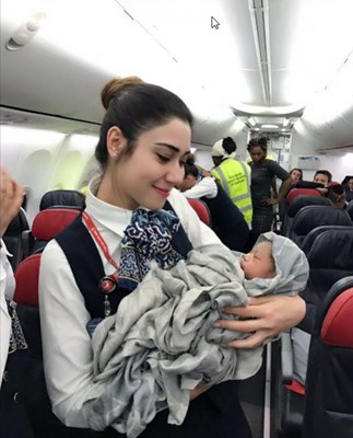 The nationality of baby born mid-flight is still uncertain