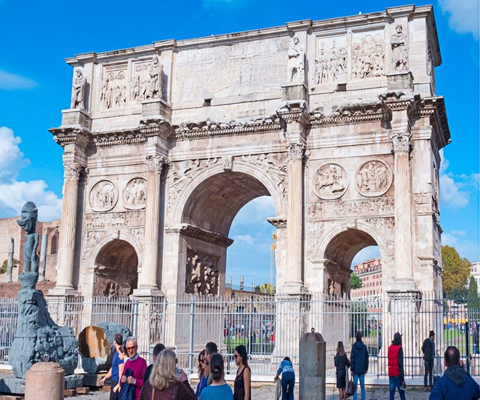 The Arch of Constantine was  built in 315 AD and is situated next to  the Colosseum.