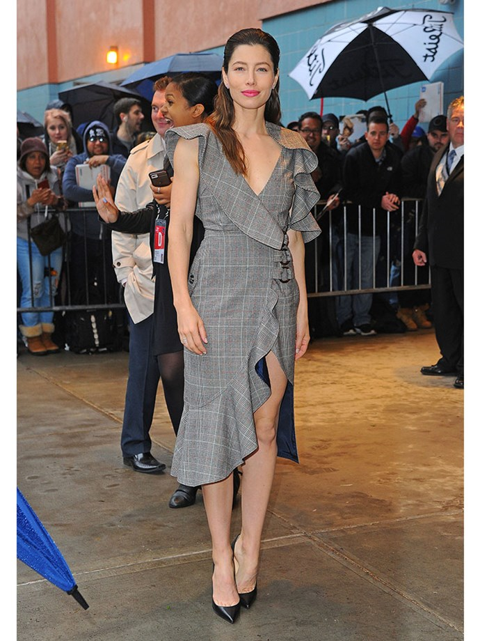 Jessica Biel's tweed Self-Portrait dress is anything but twee, with a thigh-high slit and off-the-shoulder ruffles, teamed with sleek hair and black heels.