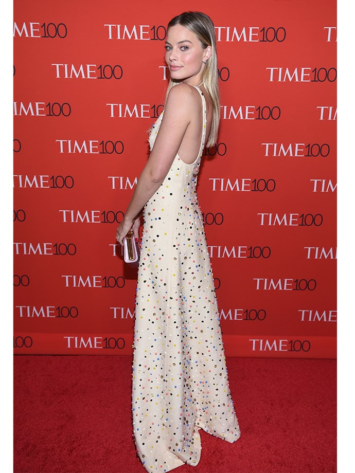 Actor and newly-wed Margot Robbie wore just the right amount of diamonds in this streamlined Prada dress.