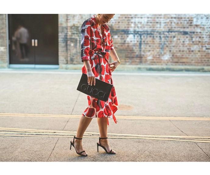 Stella McCartney dress and Gucci bag captured by Boni Febrianda.