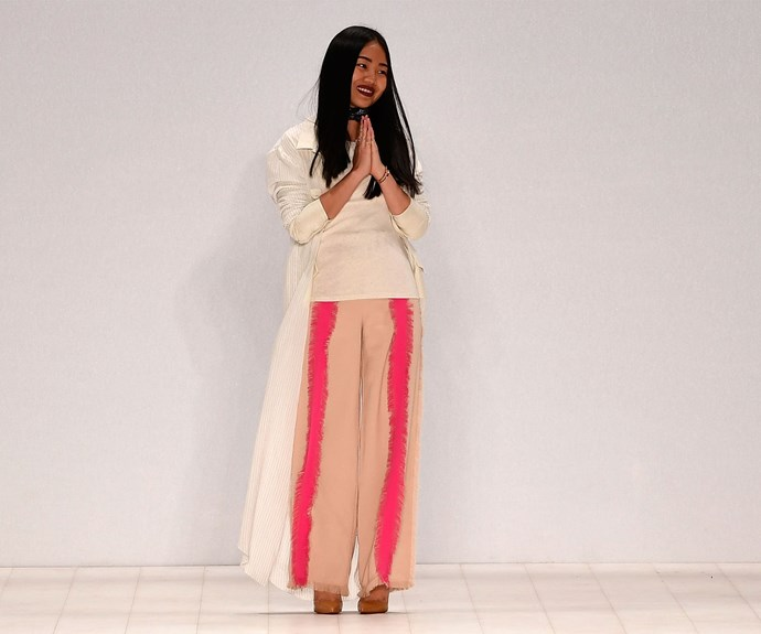 Designer Nara thanks the audience following her show during the Raffles International Showcase.