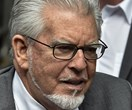Rolf Harris released from prison to face indecent assault trial