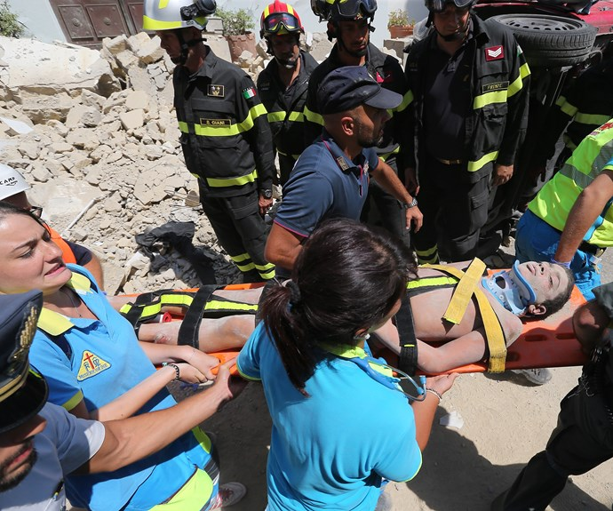 Firefighters dug with their bare hands to pull 11-year old Ciro, the last of three brothers buried in the debris.