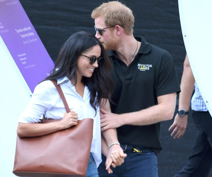 Love all! Prince Harry and Meghan Markle walk hand-in-hand at the Invictus Games
