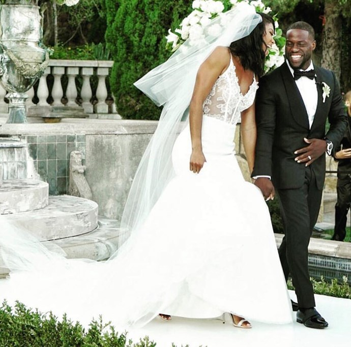 **Kevin Hart and Eniko Parrish** Funny man Kevin Hart and wife Eniko Parrish got married in a stunning Santa Barbara ceremony in August. The bride wore a Vera Wang silk crepe mermaid gown, while Kevin suited up in a sleek tux. The comedian's two children from his first marriage, daughter Heaven and son Hendrix, were both part of the big day. Photo: Instagram