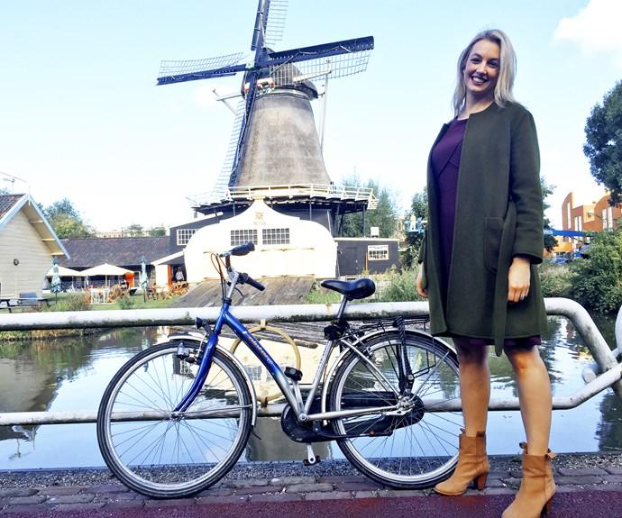 On yer bike! Janika takes in the windmills of Utrecht.