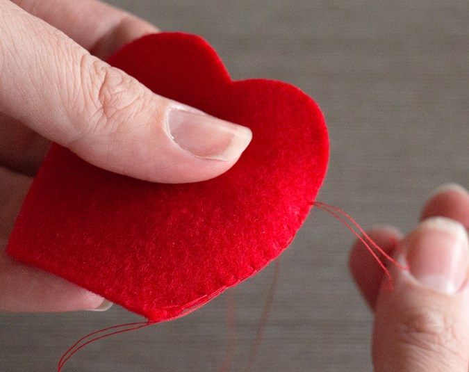 3. Using your red thread and needle, blanket stitch around the edges of all four petals. There is no need to do the straight edge along the bottom.