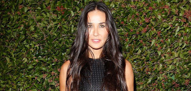Russell Brand charms Demi Moore