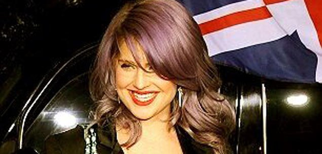 Kelly Osbourne sprains ankle to avoid falling in toilet.