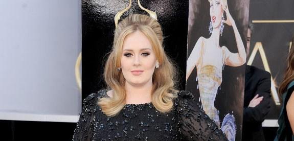 Adele gives mini Oscar to son