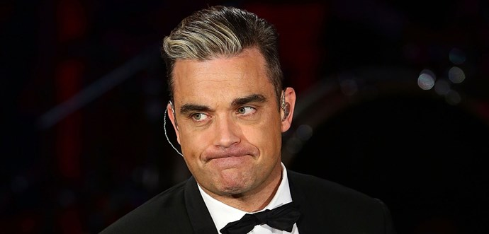 Robbie Williams admits to hair transplant