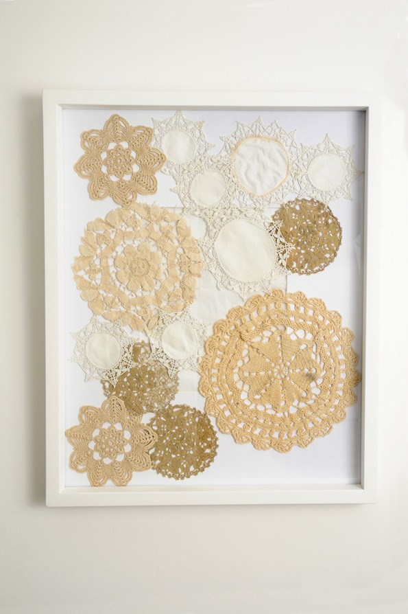 The beautfiful lace doilies that belonged to Lucia\'s great-grandmother are kept safe in a frame