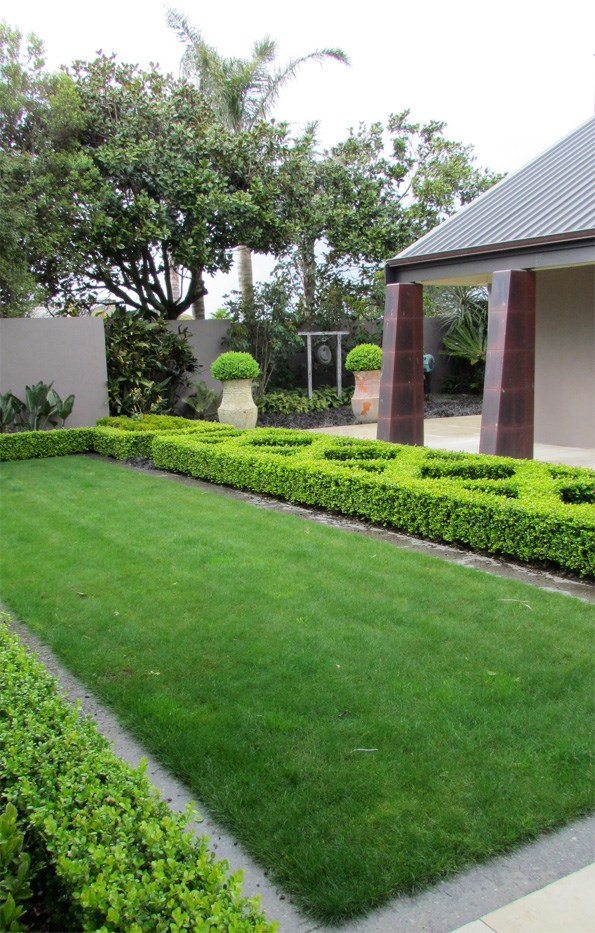 The formal elements of the gardens at Te Kukumata provide a frame for clever planting.