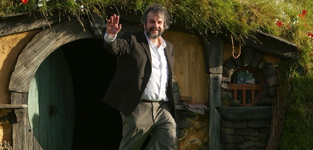 Peter Jackson emerges from a Hobbit house