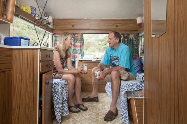 The couple's caravan is a step up from tenting.