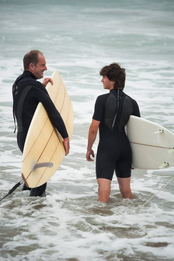 Surf's up! David and Vetya hit the water at a beach close to their Northland property.