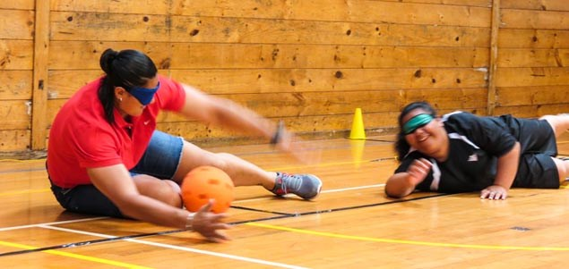 Valerie Adams helps young disabled athlete