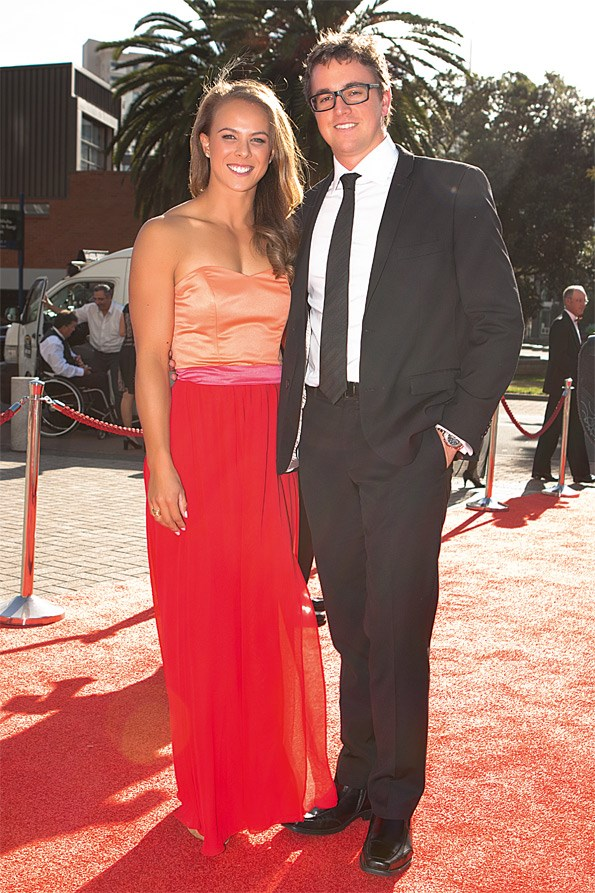 Designer Tanya Carlson put making Lisa's gown on hold to create Kerre Woodham's wedding dress.