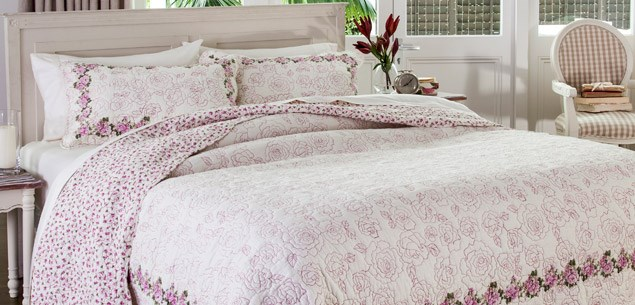 This dainty blossom quilt is $99.99 (small) and $139.99 (large), and quilted pillow covers are $22.99 each, all from EziBuy.