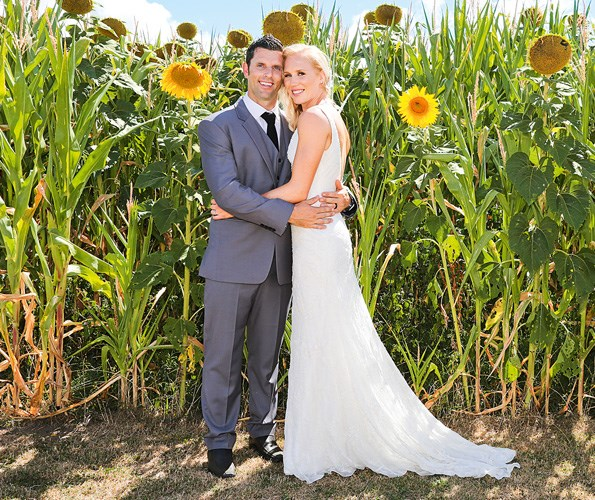 The happy couple in front of the sunflowers that Laura's brother John grew especially for the occasion.