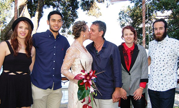 The happy couple surrounded by Kim's children (from left) Julia, James and Maude.