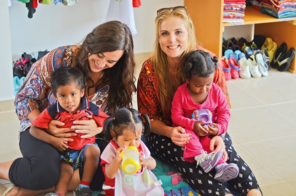 Aidee and NPH director Kristina Cavit with the youngest children in the home.