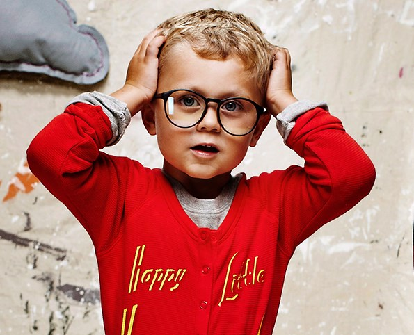 A few signs that your child may need their eyes tested include, holding books close, squinting when reading, or frequent headaches.