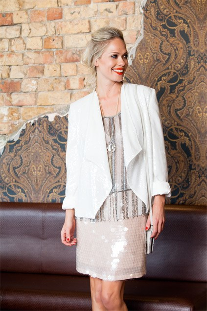Sequins: If you're not into bold colours but love to shine, sequins are a dazzling option. Nude and white tones give a fresh look and allow the sparkle to do all the work. Beaded tassel camisole $199 (6 18), sequinned blazer $179 (6-18), both from Max. Sequinned skirt $89.99 (6-16), tassel necklace $34.99, both from Portmans. Zigzag bag $39.99 from Equip.