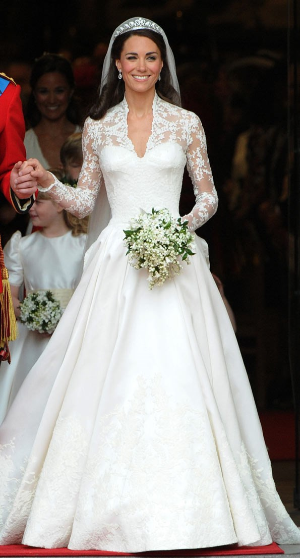 Kate stepped out of her car on the day of her wedding to show the world her stunning gown, designed by Sarah Burton of Alexander McQueen.
