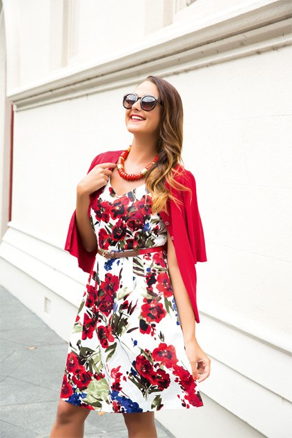 Floral-print dress $159.99 (8-16), cardi $69.99 (XS-XL), belt $29.99, all from Jacqui-E. Sunglasses $19.99, chunky bead necklace $16.99, both from Equip.