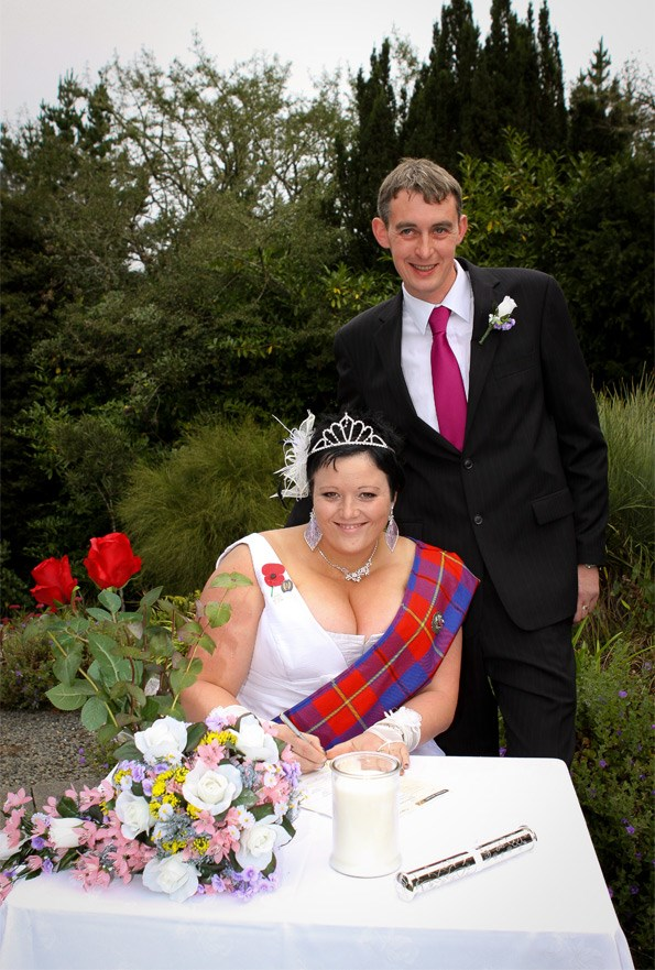 The bride, with groom Brent, wore a tartan sash with a splash of blue, and boots.