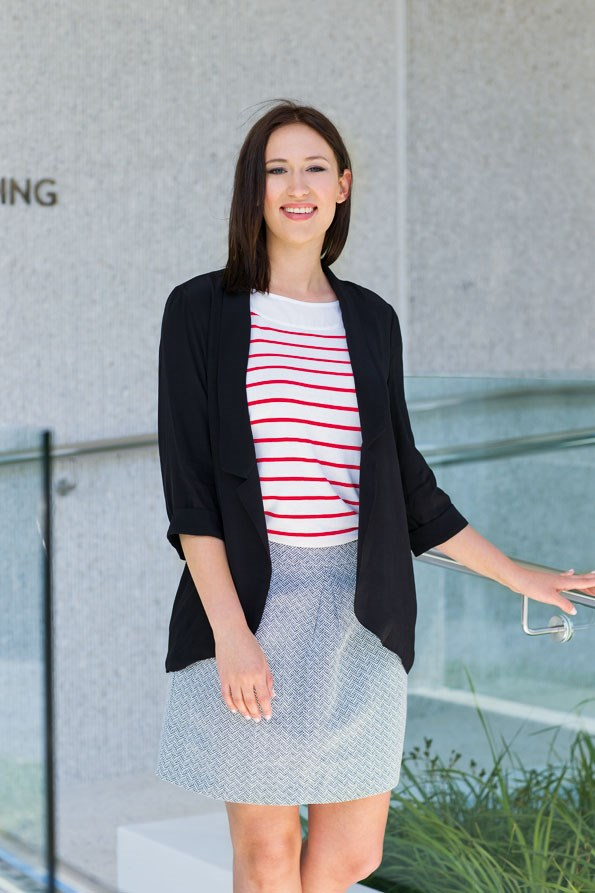 Drape blazer $49.99 from Glassons. Stripe top $39.99,  skirt $79.99 both from Portmans. A shimmery silver  skirt can still be work appropriate – tone  it down by adding stripes and darker hues on top.