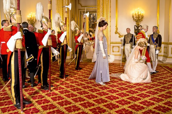 *Downton*'s resident rebel, Lady Rose (Lily James), is presented to the King and Queen as a débutante