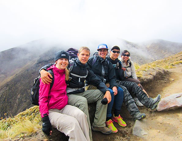 The group takes a break to appreciate the stunning views of Tongariro National Park.
