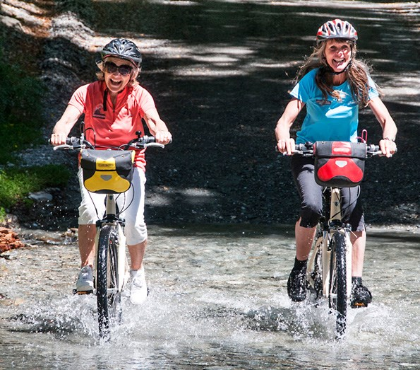 Cyclists splash through a shallow ford. Photos: Justine Tyerman, Chris Tyerman, Laurence Belcher