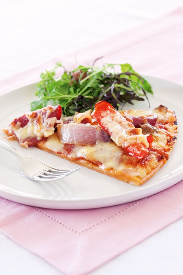 Pizza with salami and capsicum