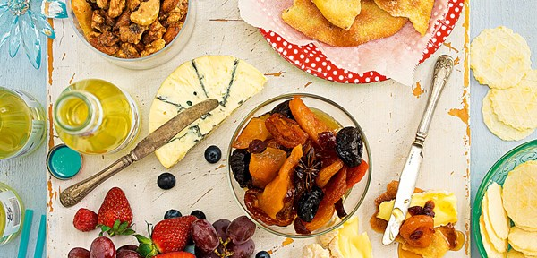 Cheeseboard with spiced nuts and marinated brandy fruits
