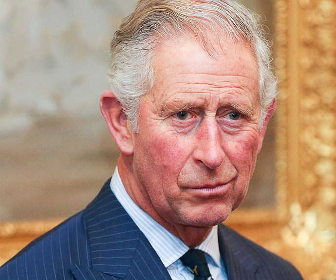 Woman steals a snog from Prince Charles