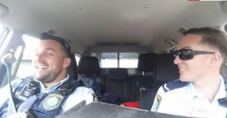 NSW police officers singing along to Frozen