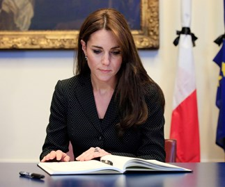 Catherine, Duchess of Cambridge, signs book of condolences for victims of Paris terror attacks
