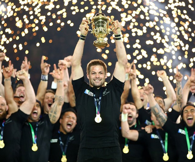 Richie McCaw holds up the Rugby World Cup trophy