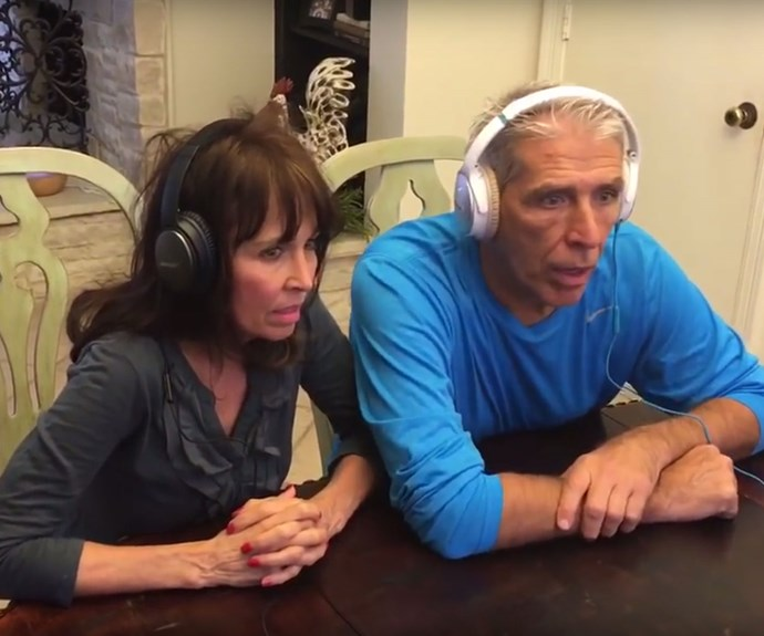 Couple wear noise cancelling headphones for daughter's pregnancy whisper challenge game.